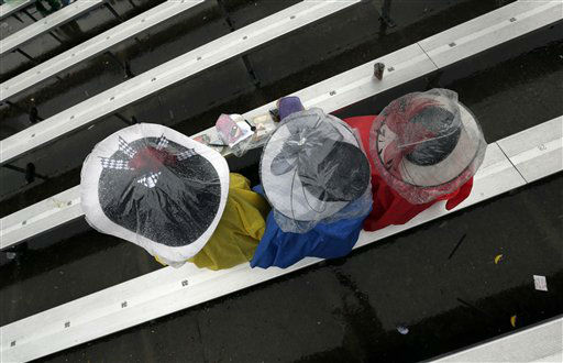 Women protect their fancy hats with plastic as they wait for the next race before the 139th Kentucky Derby at Churchill Downs Saturday, May 4, 2013, in Louisville, Ky.  <span class=meta>(AP Photo&#47; Charlie Riedel)</span>