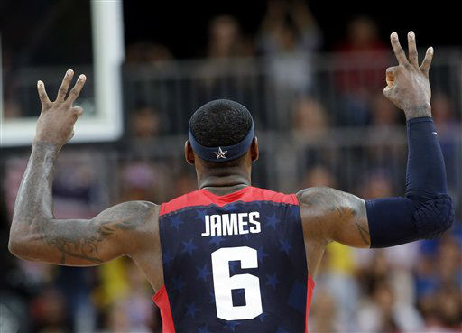 USA&#39;s Lebron James &#40;6&#41; signals after scoring with a three point basket during a preliminary men&#39;s basketball game against Lithuania at the 2012 Summer Olympics, Saturday, Aug. 4, 2012, in London. &#40;AP Photo&#47;Eric Gay&#41; <span class=meta>(AP Photo&#47; Eric Gay)</span>