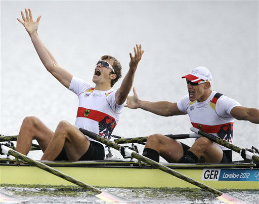 Germany&#39;s Phillipp Wende and Karl Schulze celebrate after winning the gold medal for the men&#39;s quadruple rowing sculls in Eton Dorney, near Windsor, England, at the 2012 Summer Olympics, Friday, Aug. 3, 2012. &#40;AP Photo&#47;Chris Carlson&#41; <span class=meta>(AP Photo&#47; Chris Carlson)</span>