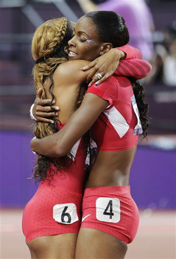United States&#39; Sanya Richards-Ross, left, is embraced by United States&#39; Deedee Trotter after she won gold in the women&#39;s 400-meter final during the athletics in the Olympic Stadium at the 2012 Summer Olympics, London, Sunday, Aug. 5, 2012. &#40;AP Photo&#47;David J. Phillip&#41; <span class=meta>(AP Photo&#47; David J. Phillip)</span>