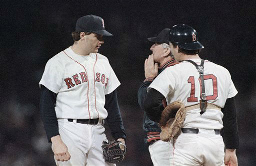 Boston Red Sox pitcher Roger Clemens speaks with manager John McNamara, center, and catcher Rich Gedman, right, as Clemens was taken out of the American League playoff game against California Angels at night on Tuesday, Oct. 7, 1986 in Boston. The Angels went on to win 8-1. &#40;AP Photo&#47;Rusty Kennedy&#41; <span class=meta>(AP Photo&#47; Rusty Kennedy)</span>