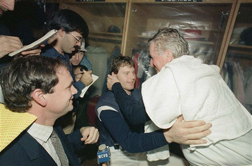 Boston Red Sox manager John McNamara, right, and starting pitcher Roger Clemens embrace in the locker room after their team defeated the California Angels 8-1 in the final game of the American League championship series, Wednesday, Oct. 25, 1986 at Boston?s Fenway Park. The Red Sox will face the New York Mets in the first game of the World Series, Saturday. &#40;AP Photo&#47;Dave Tenenbaum&#41; <span class=meta>(AP Photo&#47; Dave Tenenbaum)</span>