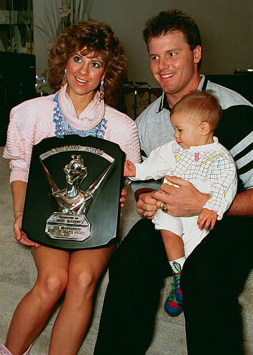 Boston Red Sox pitcher Roger Clemens poses at home with his wife, Debbie, holding his Cy Young Award, and their 11-month-old son Kody in Katy, Texas, Wednesday, Nov. 11, 1987.  Clemens is awarded his second consecutive American League Cy Young Award.  &#40;AP Photo&#47;Rick McFarland&#41; <span class=meta>(AP Photo&#47; RICK MCFARLAND)</span>