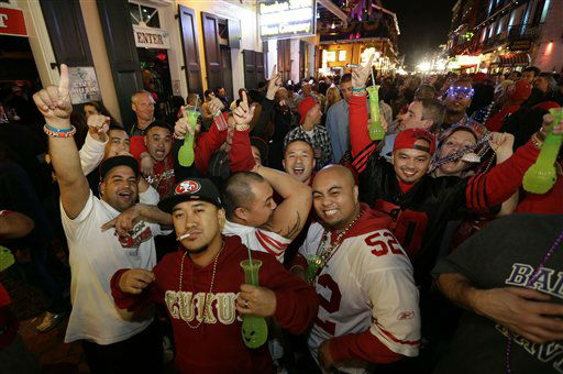 "<div class=""meta image-caption""><div class=""origin-logo origin-image ""><span></span></div><span class=""caption-text"">San Francisco 49ers fans cheer for their team as they walk along Bourbon Street in the French Quarter Saturday, Feb. 2, 2013, in New Orleans. The Baltimore Ravens will face the San Francisco 49ers in NFL football's Super Bowl XLVII on Sunday. (AP Photo/Dave Martin) (AP Photo/ Dave Martin)</span></div>"