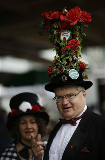 Tim Rask, from Iowa City, Iowa, shows off his fancy hat with Theresa Klingenberg before the running of the 139th Kentucky Derby at Churchill Downs Saturday, May 4, 2013, in Louisville, Ky.   <span class=meta>(AP Photo&#47; David Goldman)</span>