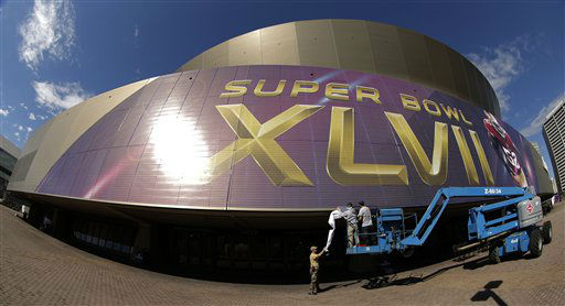 In this photo taken with a fisheye lens, workers put up signage outside the Superdome where tomorrow&#39;s NFL Super Bowl XLVII football game between the San Francisco 49ers and Baltimore Ravens will be played, Saturday, Feb. 2, 2013, in New Orleans. &#40;AP Photo&#47;Charlie Riedel&#41; <span class=meta>(AP Photo&#47; Charlie Riedel)</span>