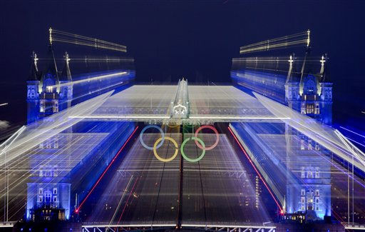 The iconic Tower Bridge over the River Thames in central London, decorated with Olympic rings, is seen in this zoom exposure, during the Opening Ceremony at the 2012 Summer Olympics, Friday, July 27, 2012, in London.   <span class=meta>(AP Photo&#47; Vadim Ghirda)</span>