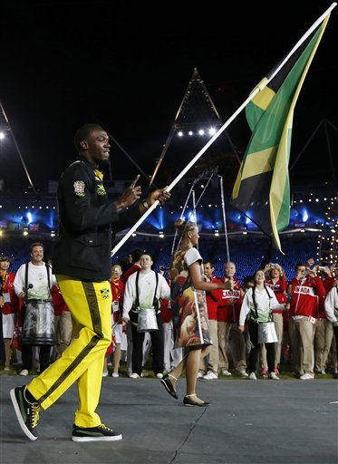 Jamaica&#39;s Usain Bolt carries the flag  during the Opening Ceremony at the 2012 Summer Olympics, Friday, July 27, 2012, in London.   <span class=meta>(AP Photo&#47; Matt Dunham)</span>