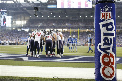 Houston Texans huddle up in front of the goal post wrapped with a Play 60 logo in the fourth quarter of an NFL football game at Ford Field in Detroit, Thursday, Nov. 22, 2012.   <span class=meta>(AP Photo&#47; Rick Osentoski)</span>