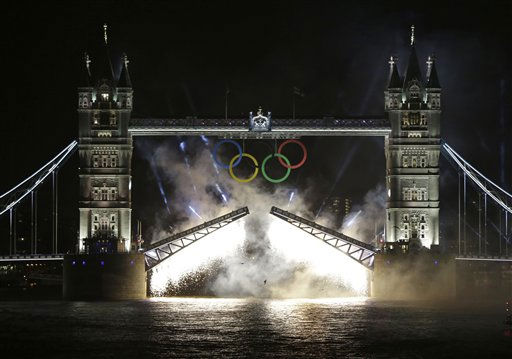 Smoke from fireworks surrounds the iconic Tower Bridge over the River Thames in central London, decorated with Olympic rings, during the Opening Ceremony at the 2012 Summer Olympics, Friday, July 27, 2012, in London.   <span class=meta>(AP Photo&#47; Lefteris Pitarakis)</span>