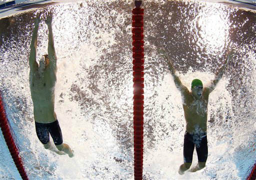 United States&#39; Michael Phelps touches the wall as South Africa&#39;s Chad le Clos closes in for second place during the men&#39;s 100-meter butterfly final at the Aquatics Centre in the Olympic Park during the 2012 Summer Olympics in London, Friday, Aug. 3, 2012. &#40;AP Photo&#47;Mark J. Terrill&#41; <span class=meta>(AP Photo&#47; Mark J. Terrill)</span>