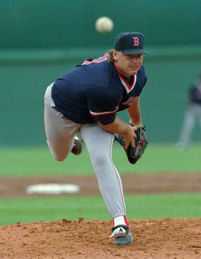 Boston Red Sox pitcher Roger Clemens follows through on a first inning pitch as he made his exhibition season start against the Minnesota Twins in Fort Myers, Fla., Saturday, March 2, 1996. Clemens gave up two hits in his three-inning outing. &#40;AP Photo&#47;Jim Mone&#41; <span class=meta>(AP Photo&#47; JIM MONE)</span>