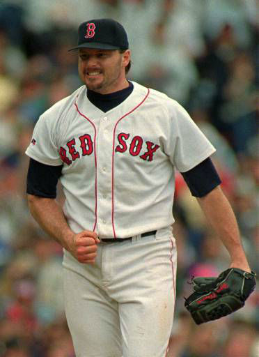 Boston Red Sox pitcher Roger Clemens pumps his fist after striking out Oakland Athletics Jose Herrera to end the seventh inning at Fenway Park in Boston Saturday, May 18, 1996. Clemens struck out ten and gave up four hits over 7 1&#47;3 innings. &#40;AP Photo&#47;Winslow Townson&#41; <span class=meta>(AP Photo&#47; WINSLOW TOWNSON)</span>