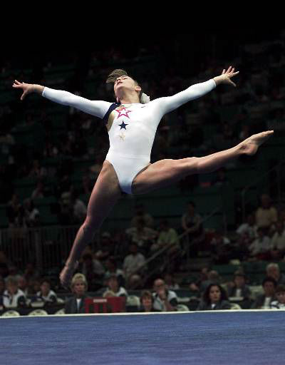 "<div class=""meta image-caption""><div class=""origin-logo origin-image ""><span></span></div><span class=""caption-text"">USA's Shannon Miller, of Edmond, Okla., performs her routine in the floor excercise during the women's team compulsory gymnastics competition of the Centennial Summer Olympic Games in Atlanta Sunday, July 21, 1996.  (AP Photo/Ed Reinke) (AP Photo/ ED REINKE)</span></div>"
