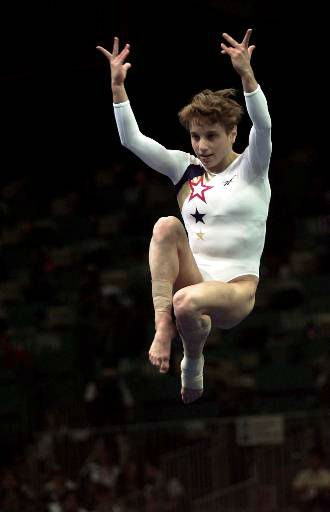 Kerri Strug, of Houston, Texas performs her routine on the vault during the women&#39;s team gymnastics competition at the Centennial Summer Olympic Games in Atlanta on Tuesday, July 23, 1996. Strug injured her left leg following this routine. &#40;AP Photo&#47;Ed Reinke&#41; <span class=meta>(AP Photo&#47; ED REINKE)</span>
