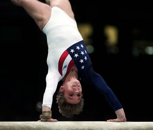 Kerri Strug, of Houston, Texas performs her routine on the vault during the women&#39;s team gymnastics competition at the Centennial Summer Olympic Games in Atlanta on Tuesday, July 23, 1996. Strug injured her left leg following this routine.  &#40;AP Photo&#47;John Gaps III&#41; <span class=meta>(AP Photo&#47; JOHN GAPS III)</span>