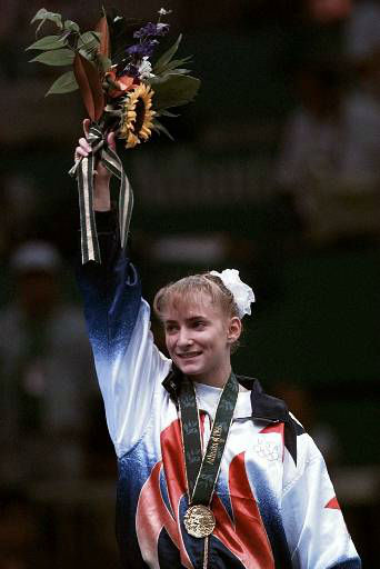 Shannon Miller, of Edmond, Okla, acknowledges the crowd after being awarded the gold medal in the balance beam during the women&#39;s individual event gymnastics finals at the Centennial Summer Olympic Games in Atlanta Monday, July 29, 1996.  &#40;AP Photo&#47;Susan Ragan&#41; <span class=meta>(AP Photo&#47; SUSAN RAGAN)</span>