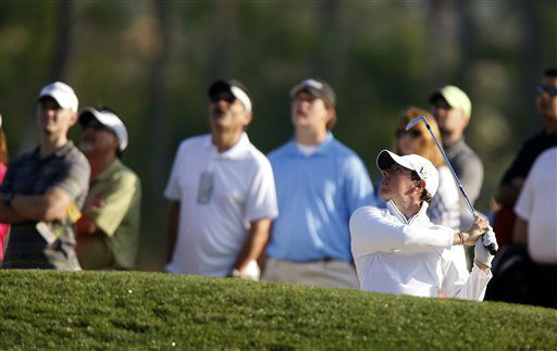 "<div class=""meta ""><span class=""caption-text "">Rory Mcllroy, of Northern Ireland,  hits out of a bunker on the 13th hole during the second round of the Houston Open golf tournament, Friday, March 29, 2013 in Humble, Texas.   (AP Photo/ Jon Eilts)</span></div>"