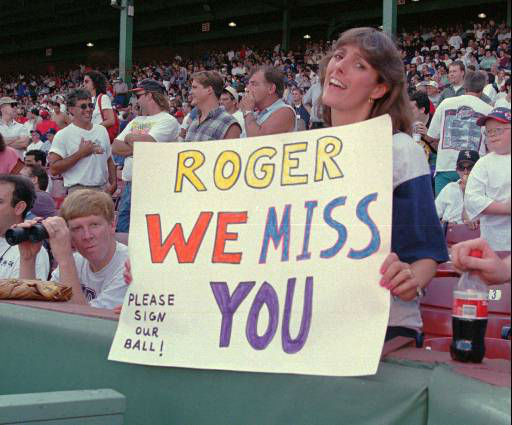 Kelly McCue of Derry, N.H., holds a sign dedicated to the Toronto Blue Jays&#39; Roger Clemens at Fenway Park in Boston, Mass., Saturday, July 12, 1997. Clemens pitched against the Boston Red Sox for the first time since leaving the Red Sox last winter. &#40;AP Photo&#47;Jim Rogash&#41; <span class=meta>(AP Photo&#47; JIM ROGASH)</span>