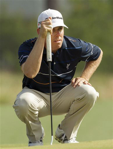 Justin Leonard lines up a putt during the first round of the Houston Open golf tournament, Thursday, March 28, 2013 in Humble, Texas.  <span class=meta>(AP Photo&#47; Bob Levey)</span>