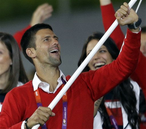 Serbia&#39;s Novak Djokovic carries the flag during the Opening Ceremony at the 2012 Summer Olympics, Friday, July 27, 2012, in London.   <span class=meta>(AP Photo&#47; David Goldman)</span>