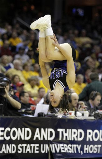 An Indiana State cheerleader flips during the first half of an East regional NCAA college basketball tournament second round game against Syracuse Friday, March 18, 2011, in Cleveland. &#40;AP Photo&#47;Amy Sancetta&#41; <span class=meta>(AP Photo&#47; Amy Sancetta)</span>