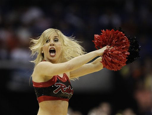 "<div class=""meta ""><span class=""caption-text "">A against UNLV cheerleader perfomrs in the first half of a Southwest Regional NCAA tournament second round college basketball game, Friday, March 18, 2011 in Tulsa, Okla. (AP Photo/Charlie Riedel) (AP Photo/ Charlie Riedel)</span></div>"