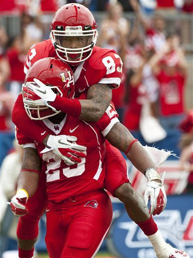 Houston&#39;s Patrick Edwards &#40;83&#41; celebrates a touchdown by Michael Hayes, bottom, during the second quarter of the Conference USA championship NCAA college football game against Southern Mississippi, Saturday, Dec. 3, 2011, in Houston. Southern Mississippi beat Houston 49-28. &#40;AP Photo&#47;Dave Einsel&#41; <span class=meta>(AP Photo&#47; Dave Einsel)</span>