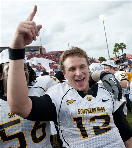 "<div class=""meta image-caption""><div class=""origin-logo origin-image ""><span></span></div><span class=""caption-text"">Southern Mississippi quarterback Austin Davis (12) celebrates after a Conference USA championship NCAA college football game against Houston, Saturday, Dec. 3, 2011, in Houston. Southern Mississippi defeated Houston 49-28. (AP Photo/Dave Einsel) (AP Photo/ Dave Einsel)</span></div>"