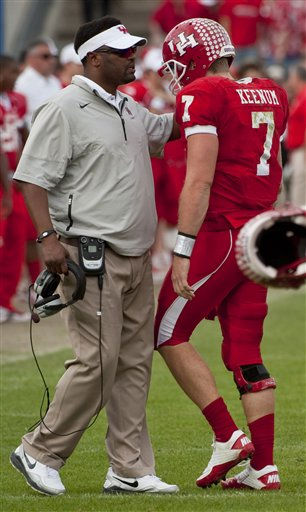 "<div class=""meta ""><span class=""caption-text "">Houston head coach Kevin Sumlin, left, talks with quarterback Case Keenum (7) following a failed fourth down-attempt during the fourth quarter of a Conference USA championship NCAA college football game against Southern Mississippi, Saturday, Dec. 3, 2011, in Houston. Southern Mississippi defeated Houston 49-28. (AP Photo/Dave Einsel) (AP Photo/ Dave Einsel)</span></div>"