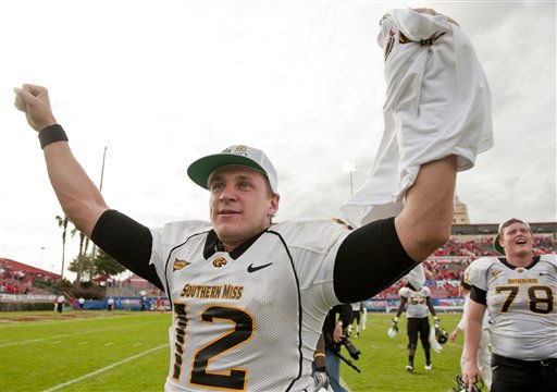 "<div class=""meta ""><span class=""caption-text "">Southern Mississippi quarterback Austin Davis (12) celebrates after a Conference USA championship NCAA college football game against Houston, Saturday, Dec. 3, 2011, in Houston. Southern Mississippi defeated Houston 49-28. (AP Photo/Dave Einsel) (AP Photo/ Dave Einsel)</span></div>"