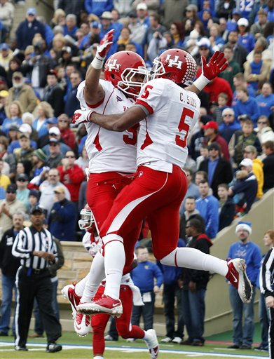 Houston&#39;s Justin Johnson &#40;3&#41; and Charles Sims &#40;5&#41; celebrate a touchdown by Sims against Tulsa in the second quarter of an NCAA college football game in Tulsa, Okla., Friday, Nov. 25, 2011. &#40;AP Photo&#47;Sue Ogrocki&#41; <span class=meta>(AP Photo&#47; Sue Ogrocki)</span>
