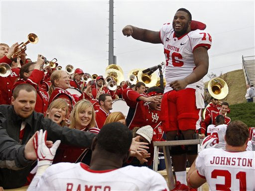 Houstons Jacolby Ashworth &#40;76&#41; and other teammates celebrate with fans following their 48-16 victory over Tulsa in an NCAA college football game in Tulsa, Okla., Friday, Nov. 25, 2011. &#40;AP Photo&#47;Sue Ogrocki&#41; <span class=meta>(AP Photo&#47; Sue Ogrocki)</span>