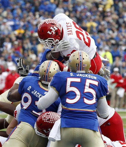 Houston running back Michael Hayes &#40;29&#41; goes up and over the Tulsa line for a touchdown in the fourth quarter of an NCAA college football game in Tulsa, Okla., Friday, Nov. 25, 2011. Houston won 48-16. &#40;AP Photo&#47;Sue Ogrocki&#41; <span class=meta>(AP Photo&#47; Sue Ogrocki)</span>