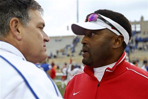 Tulsa head coach Bill Blankenship, left, and Houston head coach Kevin Sumlin, right, meet after an NCAA college football game in Tulsa, Okla., Friday, Nov. 25, 2011. Houston won 48-16. &#40;AP Photo&#47;Sue Ogrocki&#41; <span class=meta>(AP Photo&#47; Sue Ogrocki)</span>