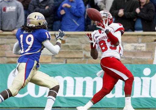 Houston wide receiver Patrick Edwards &#40;83&#41; catches a pass in front of Tulsa defender Milton Howell &#40;19&#41; and takes it in for a touchdown in the third quarter of an NCAA college football game in Tulsa, Okla., Friday, Nov. 25, 2011. Edwards had 181 yards receiving and four scores in Houston&#39;s 48-16 wiin. &#40;AP Photo&#47;Sue Ogrocki&#41; <span class=meta>(AP Photo&#47; Sue Ogrocki)</span>