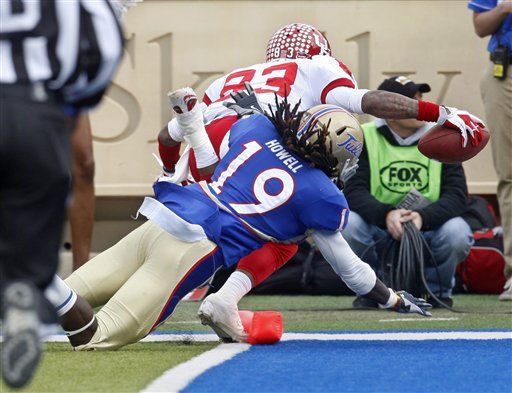 Houston wide receiver Patrick Edwards &#40;83&#41; scores in front of Tulsa defender Milton Howell &#40;19&#41; in the third quarter of an NCAA college football game in Tulsa, Okla., Friday, Nov. 25, 2011. Edwards had 181 yards receiving and four scores as Houston won 48-16. &#40;AP Photo&#47;Sue Ogrocki&#41; <span class=meta>(AP Photo&#47; Sue Ogrocki)</span>