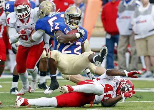 Tulsa tailback Trey Watts &#40;22&#41; sails over the top of Houston&#39;s Braxton Welford &#40;40&#41; in the third quarter of an NCAA college football game in Tulsa, Okla., Friday, Nov. 25, 2011. &#40;AP Photo&#47;Sue Ogrocki&#41; <span class=meta>(AP Photo&#47; Sue Ogrocki)</span>
