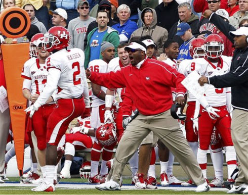 Houston head coach Kevin Sumlin reacts on the sidelines after defensive back D.J. Hayden &#40;2&#41; broke up a Tulsa pass play in the fourth quarter of an NCAA college football game in Tulsa, Okla., Friday, Nov. 25, 2011. Houston won 48-16. &#40;AP Photo&#47;Sue Ogrocki&#41; <span class=meta>(AP Photo&#47; Sue Ogrocki)</span>