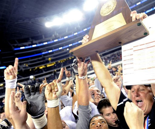 Pearland head coach Tony Heath holds up the Class 5A Division I UIL state championship football trophy after his team beat Euless Trinity 28-24, Saturday, Dec 18, 2010, at Cowboys Stadium in Arlington, Texas. &#40;AP Photo&#47;Matt Strasen&#41; <span class=meta>(AP Photo&#47; Matt Strasen)</span>