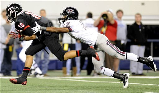 Euless Trinity&#39;s Enrique Oquendo &#40;18&#41; is tackled by Pearland&#39;s Charleston Higginbotham &#40;22&#41; after making a catch in the third quarter during their Class 5A Division I UIL state championship football game, Saturday, Dec 18, 2010, at Cowboys Stadium in Arlington, Texas. Pearland won 28-24. &#40;AP Photo&#47;Matt Strasen&#41; <span class=meta>(AP Photo&#47; Matt Strasen)</span>
