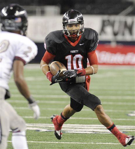 Euless Trinity&#39;s quarterback Brandon Carter &#40;10&#41; looks for running room around Pearland&#39;s Charleston Higginbotham &#40;22&#41; in the second quarter during the Class 5A Division I UIL state championship football game, Saturday, Dec 18, 2010, at Cowboys Stadium in Arlington, Texas.  &#40;AP Photo&#47;Matt Strasen&#41; <span class=meta>(AP Photo&#47; Matt Strasen)</span>
