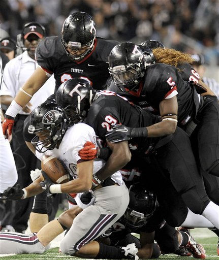 Pearland&#39;s Dustin Garrison &#40;29&#41; is tackled by a group of Euless Trinity defenders, including Dez Richardson &#40;29&#41; and Brian Nance &#40;5&#41;, in the first quarter during the Class 5A Division I UIL state championship football game, Saturday, Dec. 18, 2010, at Cowboys Stadium in Arlington, Texas.  &#40;AP Photo&#47;Matt Strasen&#41; <span class=meta>(AP Photo&#47; Matt Strasen)</span>