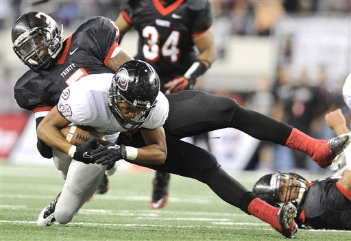 Pearland&#39;s Dustin Garrison &#40;29&#41; is tackled by Euless Trinity&#39;s Brian Nance &#40;5&#41; in the second quarter during the Class 5A Division I UIL state championship football game, Saturday, Dec. 18, 2010, at Cowboys Stadium in Arlington, Texas.  &#40;AP Photo&#47;Matt Strasen&#41; <span class=meta>(AP Photo&#47; Matt Strasen)</span>