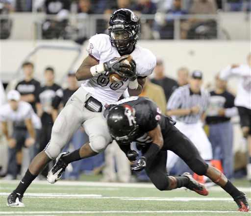 Pearland&#39;s Samuel Ukwuachu &#40;86&#41; reacts to being hit by Euless Trinity&#39;s Devonte Simmons &#40;25&#41; during the Class 5A Division I UIL state championship football game, Saturday, Dec. 18, 2010, at Cowboys Stadium in Arlington, Texas.  &#40;AP Photo&#47;Matt Strasen&#41; <span class=meta>(AP Photo&#47; Matt Strasen)</span>