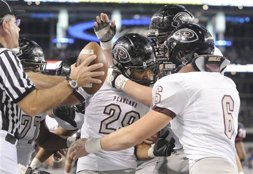 Pearland&#39;s Dustin Garrison &#40;29&#41; is congratulated by teammates, including John Gibberman &#40;6&#41;, after Garrison&#39;s touchdown in the second quarter during the Class 5A Division I UIL state championship football game against the Euless Trinity, Saturday, Dec 18, 2010, at Cowboys Stadium in Arlington, Texas.  &#40;AP Photo&#47;Matt Strasen&#41; <span class=meta>(AP Photo&#47; Matt Strasen)</span>