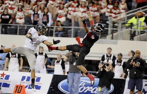 Euless Trinity&#39;s, Brandon Carter &#40;10&#41; has the ball go through his hands as Pearland&#39;s, Dustin Garrison &#40;29&#41; defends on Euless Trinity&#39;s final of the game, during their Class 5A Division I UIL state championship football game, Saturday, Dec 18, 2010, at Cowboys Stadium in Arlington, Texas. Pearland won 28-24. &#40;AP Photo&#47;Matt Strasen&#41; <span class=meta>(AP Photo&#47; Matt Strasen)</span>