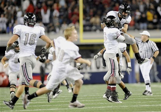 Pearland players celebrate on the field after their final defensive stop in the fourth quarter during their Class 5A Division I UIL state championship football game, Saturday, Dec 18, 2010, at Cowboys Stadium in Arlington, Texas. Pearland won 28-24. &#40;AP Photo&#47;Matt Strasen&#41; <span class=meta>(AP Photo&#47; Matt Strasen)</span>