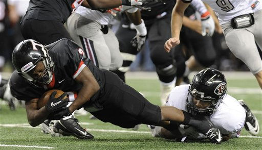 Euless Trinity&#39;s running back Terrrence Tusan &#40;2&#41; is tackled by Pearland&#39;s  Charleston Higginbotham &#40;22&#41; in the third quarter during their Class 5A Division I UIL state championship football game, Saturday, Dec 18, 2010, at Cowboys Stadium in Arlington, Texas. Pearland won 28-24. &#40;AP Photo&#47;Matt Strasen&#41; <span class=meta>(AP Photo&#47; Matt Strasen)</span>