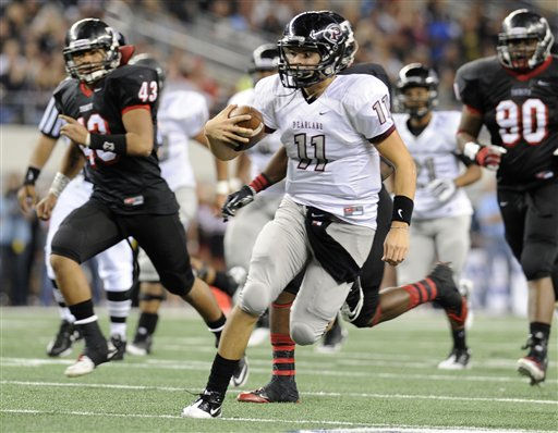 "<div class=""meta ""><span class=""caption-text "">Pearland quarterback Trey Anderson (11) runs upfield in front of Euless Trinity's Csico Leota (43) and Andre Young (90) in the third quarter during their Class 5A Division I UIL state championship football game, Saturday, Dec 18, 2010, at Cowboys Stadium in Arlington, Texas. Pearland won 28-24. (AP Photo/Matt Strasen) (AP Photo/ Matt Strasen)</span></div>"
